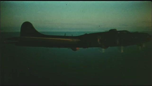 1940s: Aerial views of planes flying. View from plane, tilt up to long shot of planes in formation.