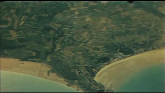 1940s: Aerial view of plane, gun in foreground. Close up of man. Aerial view of coastline. Close up of man. Aerial view of coastline.