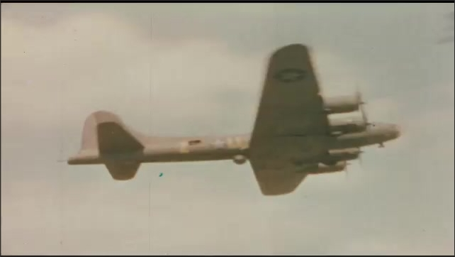 1940s: UNITED STATES: view of planes on airfield. Side profile of pilot in flight. Plane above runway