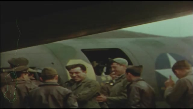1940s: UNITED STATES: Crew of Belle meet with Commander and General before mission. Men shake hands. Men get on to plane