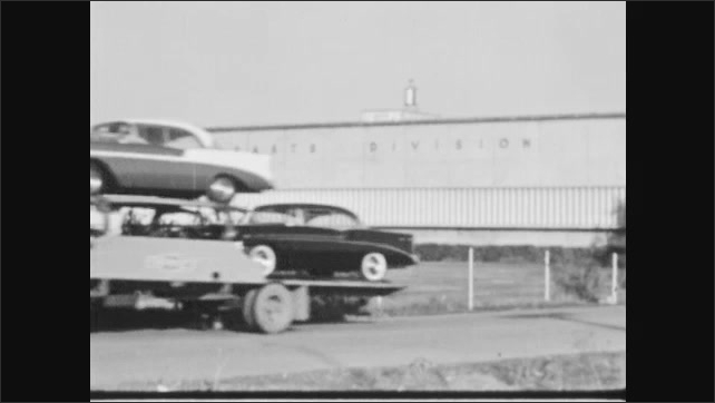 1940s: Men assemble car in factory. Car carrier transports cars down road. Men assemble chairs.