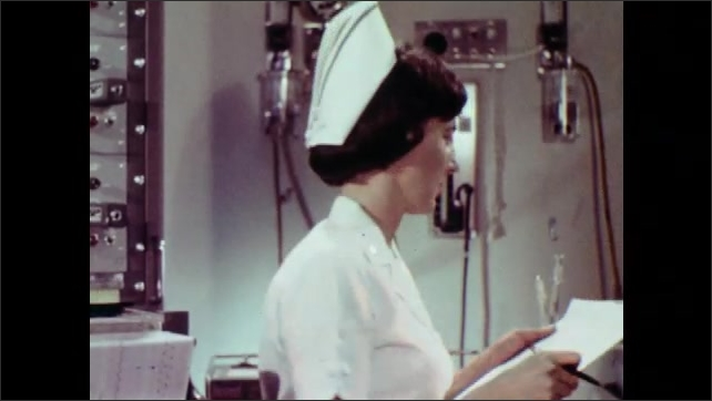 1970s: UNITED STATES: blue band on nurse's white cap. Air force nurse in uniform. Nurse attends to patient in hospital. Navy nurse in uniform