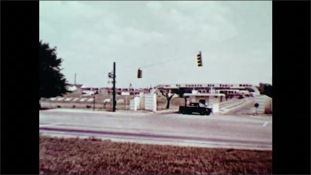 1970s: UNITED STATES: Newport US Naval Base sign and buildings. Car drives by kiosk. New military nurses in training. Close up of nurse's face