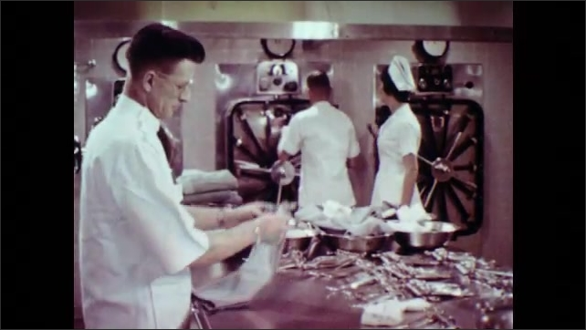 1970s: UNITED STATES: nurse sets up surgical equipment. Nurse teaches students about anatomy