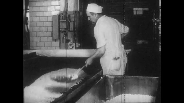 1950s: Milk mixes inside vat. Woman watches machine package ice cream. Man scoops cottage cheese into bin. Milkman loads crates into truck. Woman pushes cart through grocery, picks up milk carton.