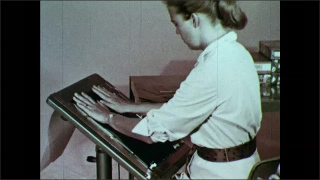 1950s: Woman secures mimeograph stencil in mimeoscope.