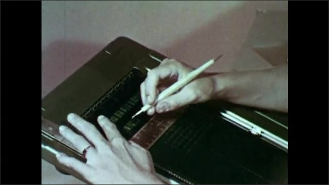 1950s: Hands pick up stencil. Woman puts stencil on mimeoscope, traces letter. Close up of woman.