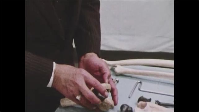 1970s: Man assembles models of bones.  Man speaks.