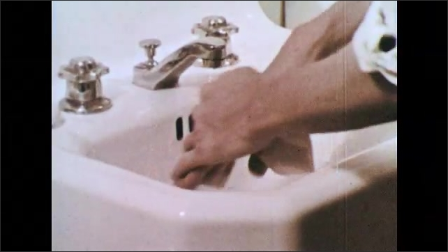 1960s: Person washes hands.  Person rubs paper towel on skin.  Cells.