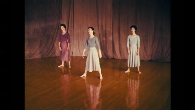 1960s: dancer runs with short, quick steps and dives on floor, trio of dancers spin into a fall and then spin to rise back up