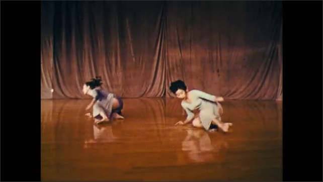 1960s: trio of dancers performing a set of techniques involving twirls, jumps, and falls