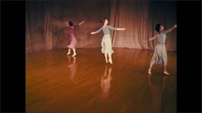 1960s: trio of dancers performing a set of techniques involving graceful twirls into falls