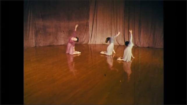 1960s: trio of dancers performing a slow fall into floor techniques