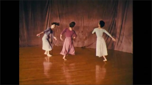 1960s: trio of dancers performing off-balance twirls while weaving around one another