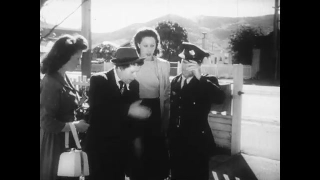 1940s: 2 women and man angrily walk up sidewalk, through picket fence gate as policeman follows, they point and talk to policeman, who tries to calm them, chimp slaps its head and hoots, goes away