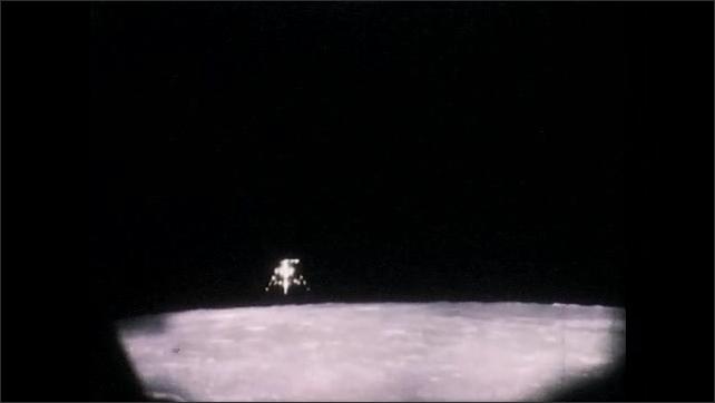 1960s: Apollo 11 spaceflight, spacecraft flies over the surface of the moon. Apollo spacecraft in lunar orbit.