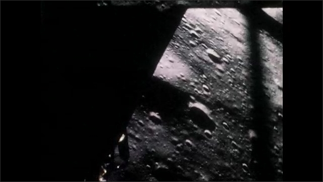 1960s: View of craters on the surface of the Moon from Apollo spacecraft in lunar orbit. Apollo 11 approaches the Moon.