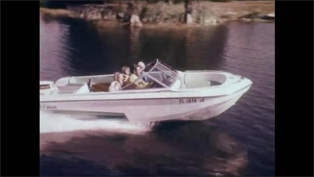 1970s: Arm pushes accelerator throttle on boat. Boat cruising through water. Speedometer on boat from 10 to 40. Boat speeds through water. Speedometer at 50. Man lowers throttle. Speedometer descends.