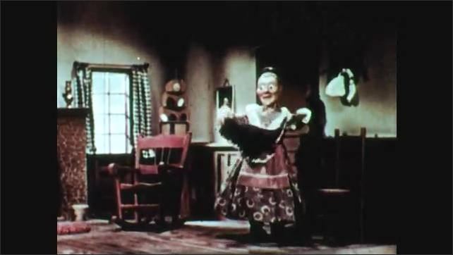 1940s: animated woman (Old Mother Hubbard) shrugs and shakes head, dog puts head down. Woman puts on hat and scarf and leaves house, waves.