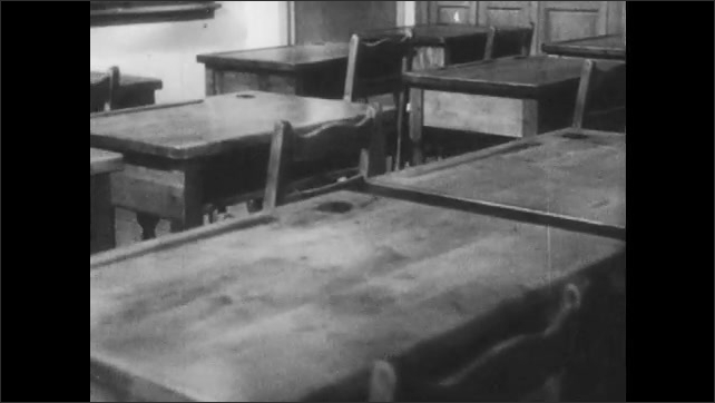 1950s: Desks and chairs in empty classroom.