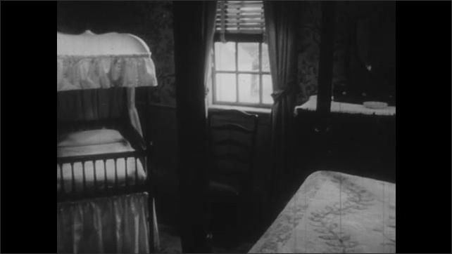 1950s: Four poster bed and dresser in Colonial bedroom. Canopied crib in bedroom. Needlepoint display on table.