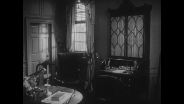 1950s: Colonial mansion with steeple. Colonial sitting room with globe and desk. Colonial writing desk. Quill pens and ink pot on desktop.