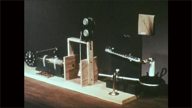 1970s: UNITED STATES: lit match by candle in experiment. Examples of potential energy in an experimental design
