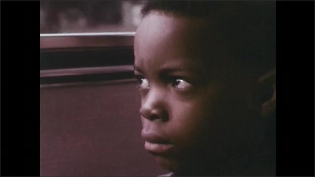 1970s: The door to the bus marked Community Service closes and it pulls out. Angry boy looks out the window and has memories of himself in abandoned buildings.