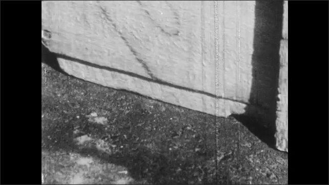1950s: Wooden box slides along pavement. Boys use rope to pull box of comics along driveway. Wooden box slides along pavement. Boys wind rope and talk. Boys sit on box of comics.