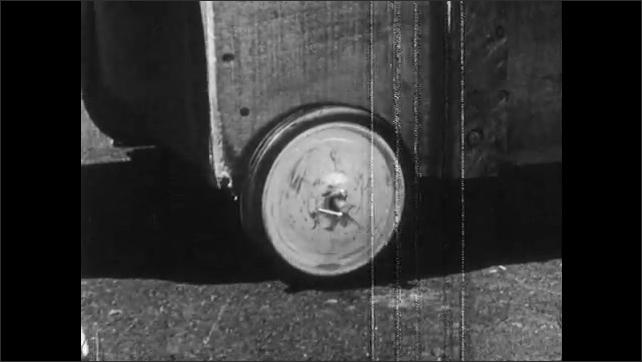 1950s: Hand applies oil to wheel and axle. Hand spins metal wheel.