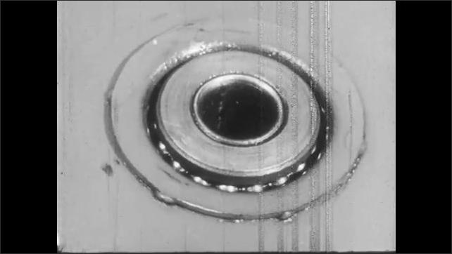 1950s: Ball bearing wheel spins around metal axle.