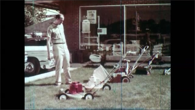 1960s: Man with hand on chin looks from left to right and back again. Man walks on lawn while looking at various models of power lawn mowers. Man stands behind one of the mowers and mimics using it.