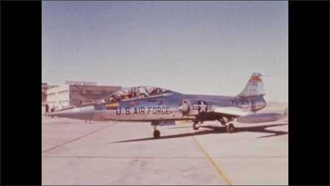1960s: UNITED STATES: US Airforce fast jet plane on tarmac. Jet aircraft at airport