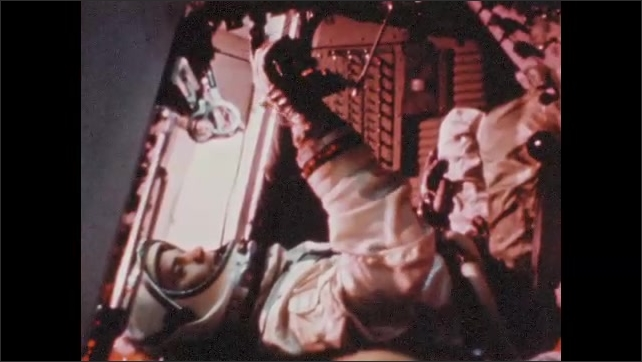 1960s: UNITED STATES: Astronaut flies aircraft in space suit. Gemini mock-up.
