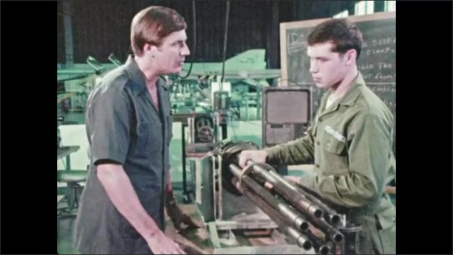 1970s: UNITED STATES: fighter bomber gun rotates slowly. Student learns about weapons. Man talks to Airforce cadet