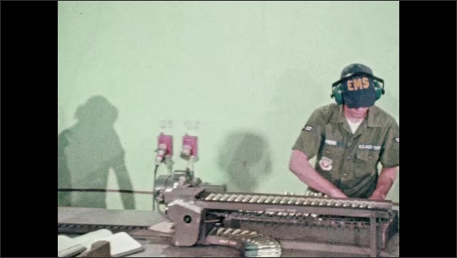 1970s: UNITED STATES: hand grabs bullets from container. Men load bullets onto conveyor. Men prepare ammunitions