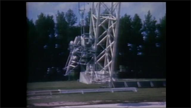 1990s: Pilot tests lunar lander flight simulator.