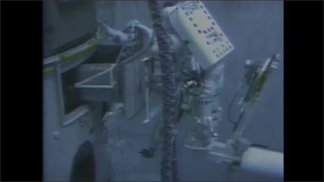 1990s: UNITED STATES: telescope in payload bay. Planetary camera. Astronauts train under water at Johnson Centre.