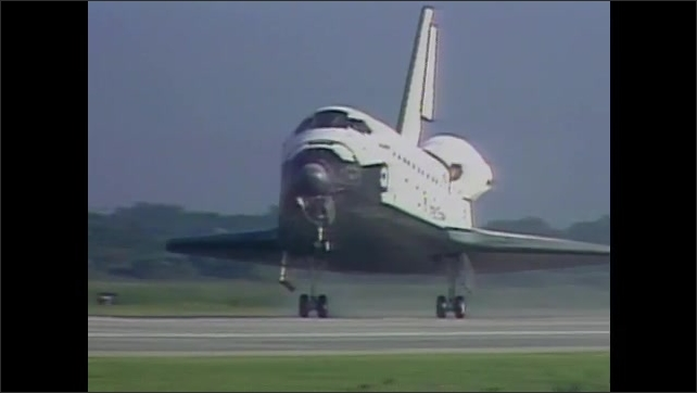 1990s: Space shuttle lands on runway. Vehicle launches on track.