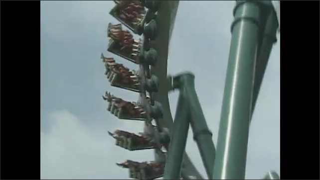 1990s: People ride roller coasters.