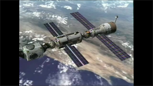2000s:??Animation of Service Model, coupling with the Zarya module. Astronauts spinning inside of space capsule.??