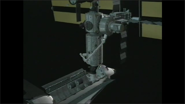 2000s:Animation of pressured mating adaptor ready to receive shuttle on Unity Bridge. Woman NASA worker explains how goods arrive on ISS. Teenage boy and girl ask questions.