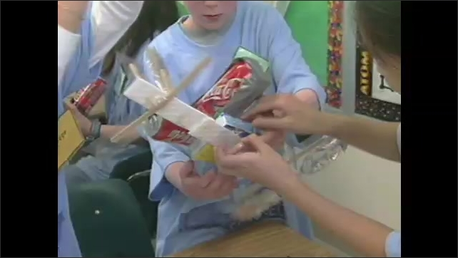 2000s:??Children sketch ideas for spaceship. Children make models of spaceships out of coke cans, foam and duct tape. Students weigh their models on balance scales.