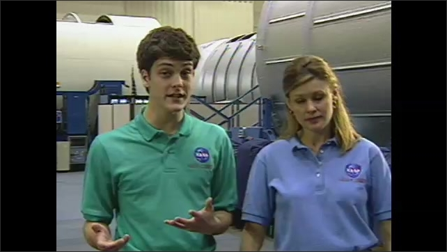 2000s:??Students and NASA workers talk about a NASA website and fistbump each other. Two teenagers in NASA polos talk and explain.??