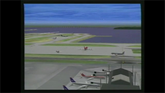 1990s: View of computer drives. Animation of plane taking off from runway. Planes at airport. Planes on runways. Planes moving on runway.