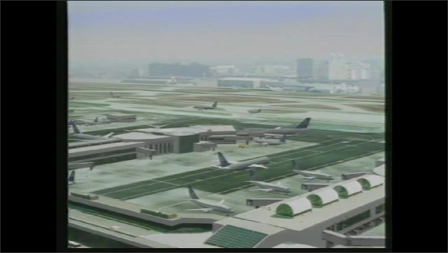 1990s: Animation of airport, planes on runways.