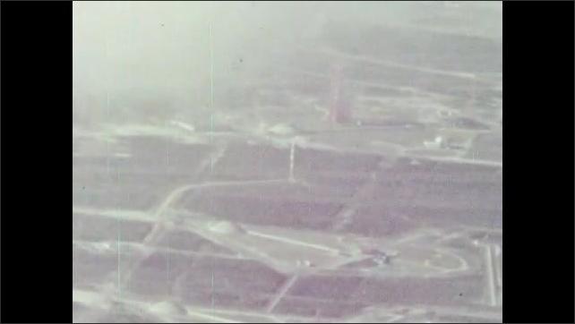 1960s: Launch pad.  Rocket launches.  Smoke.