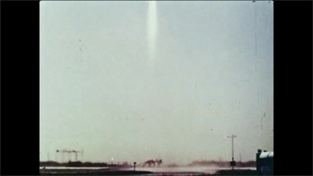 1960s: Rocket liftoff, a trail of smoke and flames come out from the rocket while it flies. Rocket flies in the atmosphere.