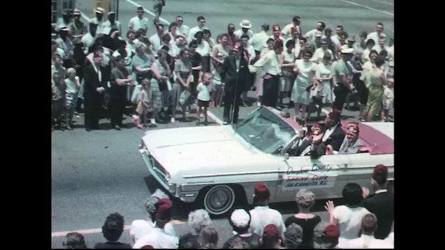 UNITED STATES 1960s: Car with 'Onslow County Shrine Club' banner in parade, woman crosses street / 'Onslow County' car / Shriners in 'Onslow County' convertible /  Shriner in convertible.