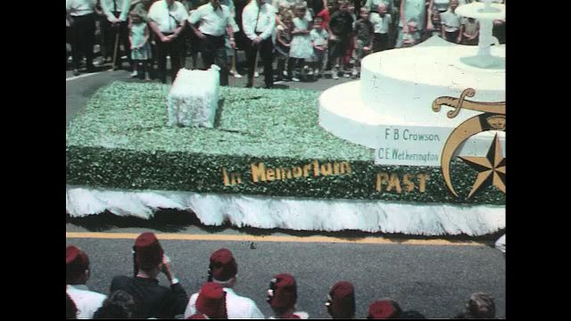 UNITED STATES 1960s: Goldsboro Shriner memorial float in parade / Painted double-decker bus with Shriners / Shriners in convertible.